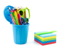 Multicolor memo pad and mini container filled with pens and penc Royalty Free Stock Photos