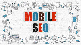 Multicolor Mobile SEO on White Brickwall. Doodle Style. Royalty Free Stock Images