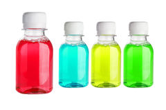 Multicolor Mouth Wash. In Plastic Bottles on White Background Stock Photo