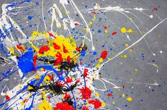 Multicolor paint dripping on background. Stylish acrylic liquid layered colorful painting concept.  stock photos