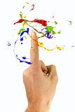Multicolor paint levitate around forefinger Royalty Free Stock Photography