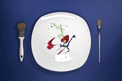 Paint on the plate with paint brushes on side Royalty Free Stock Photos