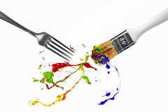 Paint splash between fork and paintbrush Royalty Free Stock Photography