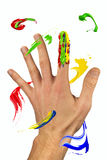 Paint strokes flying around the hand Stock Image