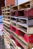 Multicolor pallets stacked up stock photo