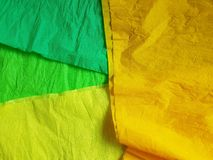 Multicolor paper background silk surface empty blank sheets vivid colors. Wrapping Stock Image