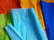 Multicolor paper background silk surface empty blank sheets vivid colors. Wrapping Stock Photography
