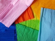 Multicolor paper background silk surface empty blank sheets vivid colors. Wrapping Royalty Free Stock Photo