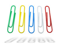 Multicolor paper clips green yellow blue Stock Photos