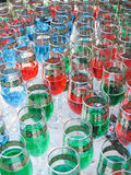 Multicolor party glasses. Bunch of red blue green party glasses Royalty Free Stock Photos