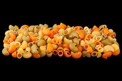 Multicolor pasta on black Royalty Free Stock Image