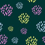 Multicolor pattern of circle hand drawn with dots on green background. Unique and beauty stock illustration