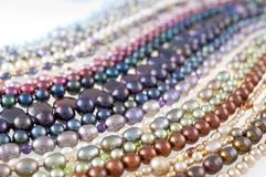 Multicolor Pearl Strands in parallel waves backlit composition stock photos