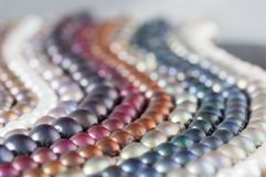 Multicolor Pearl Strands in parallel waves composition. White, blue, orange & red Royalty Free Stock Image
