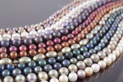 Multicolor Pearl Strands in parallel waves. Composition, white, blue, orange & red Stock Photography