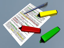 Multicolor pen markers and pen laying on a document Stock Image