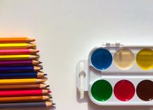 Multicolor pencils and paints Stock Image