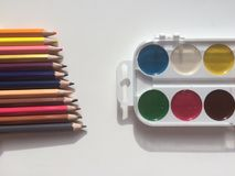 Multicolor pencils and paints Royalty Free Stock Photos