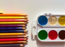 Multicolor pencils and paints Stock Photos