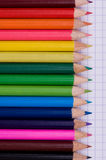 Multicolor pencils on paper Royalty Free Stock Photography