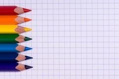 Multicolor pencils on paper Royalty Free Stock Photos