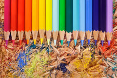 Multicolor pencils raibow on the shavings. Background Stock Photo
