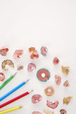 Multicolor pencils and shavings on white background with copy space Stock Image
