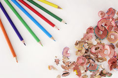 Multicolor pencils and shavings on white background with copy space Stock Photos