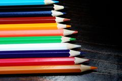 Multicolor pencils on wooden background stock images