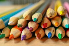 Multicolor pencils on wooden background. royalty free stock photos