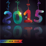 Multicolor polygons numbers hang on ribbons.New year 2015 Royalty Free Stock Images