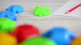 Multicolor puzzles with colorful pencils stock footage