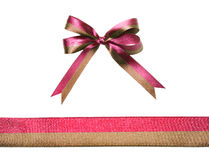 Multicolor red-brown fabric ribbon and bow isolated on a white background Stock Images