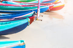 Multicolor rowboat or sea kayaks on beach with copy space. Royalty Free Stock Photography