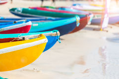 Multicolor rowboat or sea kayaks on beach with copy space. Royalty Free Stock Photos