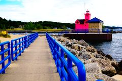 Free Multicolor Scene With A Bright Pink Beacon And A Blue Fence On The Pier. Colorfull Holland Harbor Light, Royalty Free Stock Images - 138897609