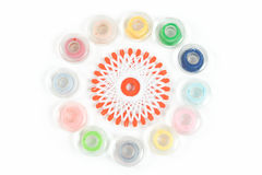 Multicolor sewing bobbin on white background. Group of multicolor sewing bobbin on white background Royalty Free Stock Photos