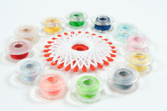 Multicolor sewing bobbin on white background Royalty Free Stock Photo