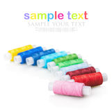 Multicolor sewing thread isolated on white background Stock Photos