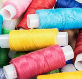 Multicolor sewing threads on background Royalty Free Stock Photo