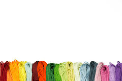 Multicolor sewing threads border Royalty Free Stock Photos