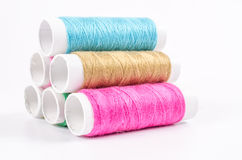 Multicolor sewing threads on white background Stock Photos