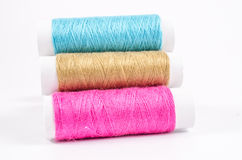 Multicolor sewing threads on white background, Royalty Free Stock Photos