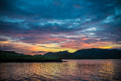 The sunset in the Flores Sea. Multicolor sky and islands on Flores sea, Indonesia Stock Image