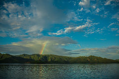 Rainbow in the Flores Sea. Multicolor sky and rainbow on Flores sea, Indonesia Royalty Free Stock Photography