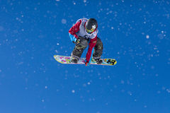 Multicolor Snowboarder Flying Mid Air. Snowboarder competing in competition in Val Thorens, France Stock Photos