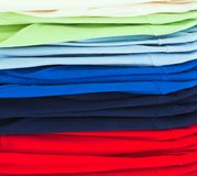 Multicolor sport shirts in store. Colourful Textile sport shirts row at store Stock Image