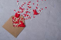 Free Multicolor Sweets Sugar Candy Hearts Fly Out Of Craft Paper Postal Envelope. Happy Valentine`s Day Concept. Royalty Free Stock Images - 109067069
