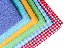 Multicolor tablecloth isolated on white, violet, blue, yellow, green. Multicolor tablecloth isolated on white, violet, blue yellow adn red Stock Image