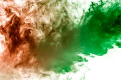 Multicolor, thick smoke, illuminated by colored in green and red light against a white isolated background, welded with clubs and stock images